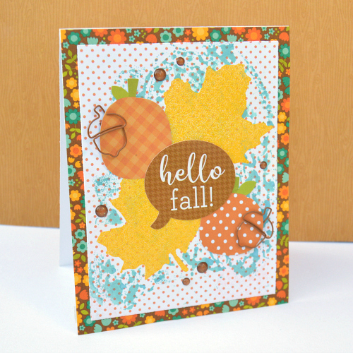 Heat embossing using adhesive sheets on a fall card