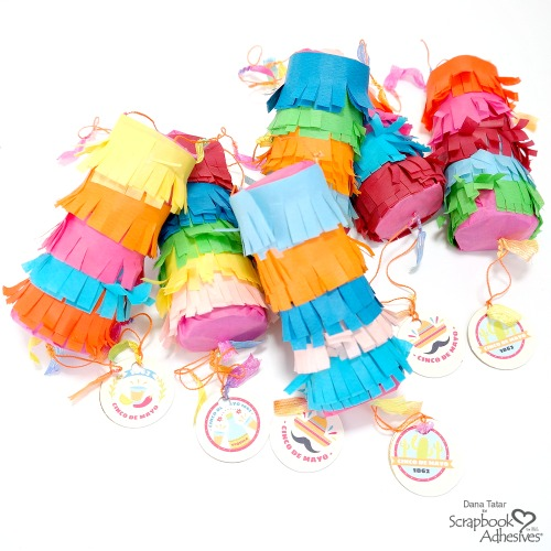 DIY Paper Roll Personal Pinatas Covered with Colorful Fringed Tissue Paper and Filled With Candy Held Together with Crafty Power Tape