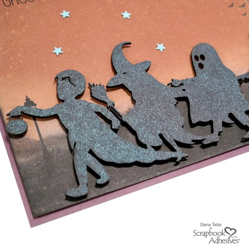 Glimmer Misted Trick-or-Treat Silhouette Chipboard Embellishment with Black 3D Foam Circles on a Halloween Card