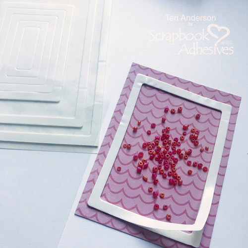 Adding beads to the Big Hello Easy Shaker Card Tutorial by Teri Anderson for Scrapbook Adhesives by 3L